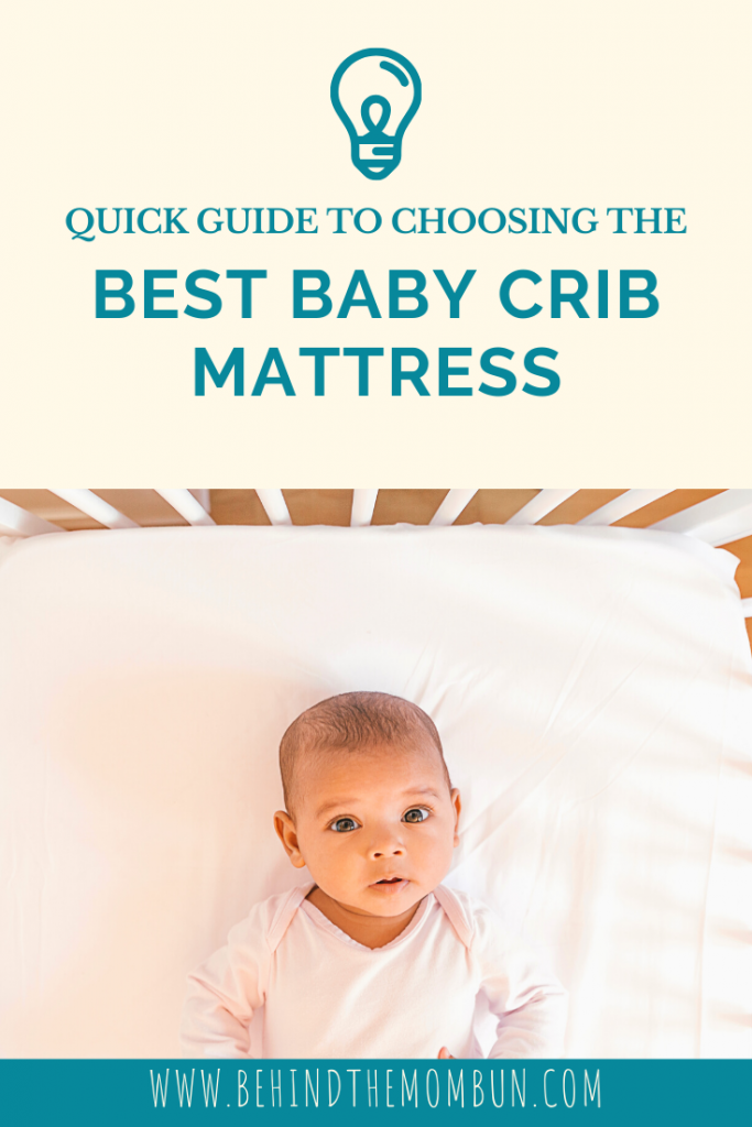 infant laying on the best baby crib mattress