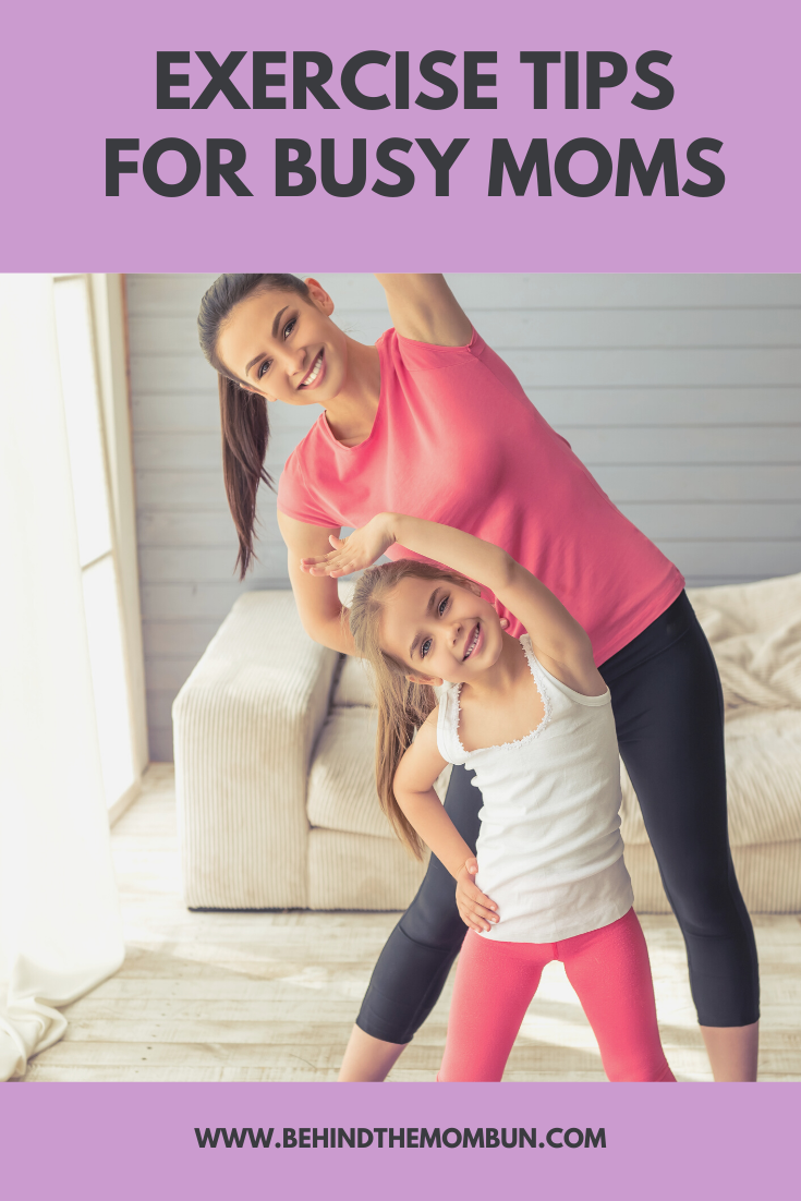busy Mom and daughter exercising together